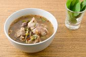 stock photo of thai cuisine  - Thai Cuisine and Food A Bowl of Thai Clear Spicy Hot and Sour Soup of Beef Entrails Served with Sweet Basils - JPG