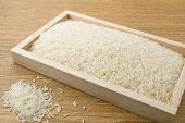 Постер, плакат: Jasmine Rice In A Brown Wooden Tray