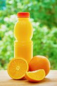 foto of orange  - Bottle with orange juice - JPG