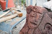 picture of stone sculpture  - Lava stone sculpture of a stylized woman - JPG