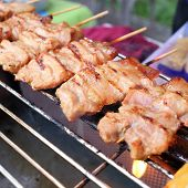 image of grill  - grilled pork on a barbecue grill thai food