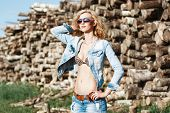 stock photo of denim jeans  - Beautiful girl in denim shorts and jeans jacket - JPG
