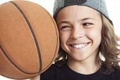 foto of ball cap  - A Portrait of young boy with basket ball - JPG