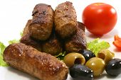 stock photo of greek food  - kebab rolls and vegetables on dish - JPG