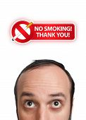 Young Man With No Smoking Sign Over His Head 2