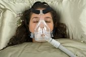 stock photo of cpap machine  - Using CPAP machine at home for sleep apnea - JPG