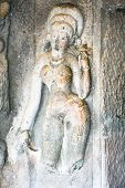 stock photo of mahadev  - Statue in ancient rock temples at Ajanta  - JPG