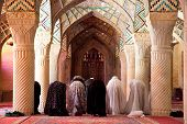 Muslim Friday pray in Prayer Hall of Nasir al-Molk Mosque, Shiraz, Iran