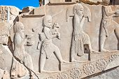 stock photo of zoroastrianism  - Bass relief decoration in central part of Persepolis complex - JPG
