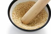 image of sesame seed  - grind sesame with mortar and wooden pestle - JPG