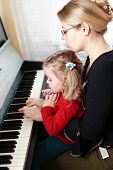 picture of musical instruments  - Mother and daughter play piano - JPG