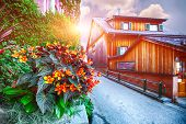 Scenic View Of Famous Hallstatt Mountain Village With Hallstatter Lake.typical Austrian Alpine House poster