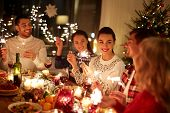 winter holidays and people concept - happy friends with sparklers celebrating christmas at home feas poster