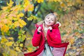 Feel So Cozy In Warm Jacket. Girl Happy In Coat Enjoy Fall Nature Park. Child Wear Fashionable Coat  poster