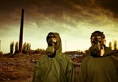 foto of gas mask  - Two man wearing gas masks after nuclear disaster - JPG