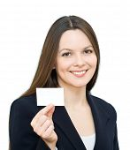 Young smiling woman with the card. Isolated on white background