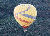 A Hot Air Balloon Soars Above Coconino National Forest, Sedona, Arizona poster