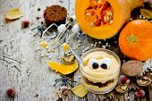 Halloween Monster Dessert In Glass, Layered Dessert Of Pumpkin Mousse With Chocolate Cookie Crumb Wi poster