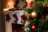 Beautiful Decorated Fireplace And Christmas Tree At Cottage. A Rich Christmas Tree With Lots Of Hang poster