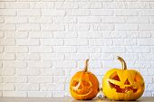 Few Orange Pumpkins Of Different Size Carved Into Jack O Lantern On Wooden Table. Background, Copy S poster