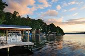 stock photo of house woods  - Lake house with pier and woods with sunrise in the morning in New York state Finger Lakes - JPG