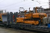 Heavy Orange Bulldozer Stands On The Flatcar Of The Train For Accident Recovery Work poster