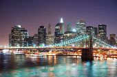 image of brooklyn bridge  - New York City Brooklyn Bridge and Manhattan skyline with skyscrapers over Hudson River illuminated with lights at dusk after sunset - JPG