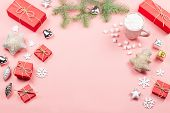 Christmas Background With Fir Tree Branches, Red Giftboxes, Decorations, Hot Drink With Marshmallows poster