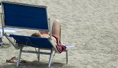 pic of nacked  - a woman with nacked relaxing on the beach - JPG