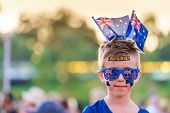 Cute Australian Boy With Flag Tattoos On His Face On Australia Day Celebration In Adelaide poster