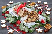 Stollen Christmas cake with gingerbread biscuits, winter flora, dried fruit and spice with decoratio poster
