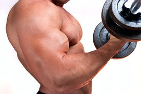stock photo of body builder  - Man with a bar weights in hands training - JPG