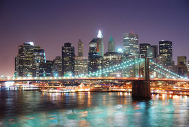 pic of brooklyn bridge  - New York City Brooklyn Bridge and Manhattan skyline with skyscrapers over Hudson River illuminated with lights at dusk after sunset - JPG