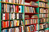 stock photo of book-shelf  - Angle shot of book shelf with big collection - JPG