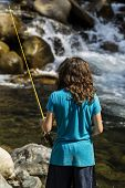 image of brook trout  - Young girl fishing in rapids of stream for trout during summer day - JPG