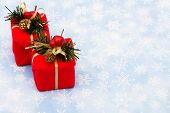 image of christmas-present  - Two red wrapped presents on snowflake background Christmas presents - JPG