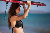 picture of boogie board  - Beautiful young woman with a body board ready to surf - JPG