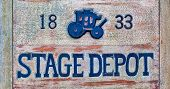 pic of stagecoach  - A stage depot sign made from wood - JPG
