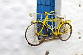 foto of greek-island  - Decorative bicycle hanging from a window in a Greek house at the Cyclades islands - JPG