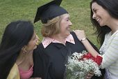 image of praising  - Older graduate receiving praise from family - JPG
