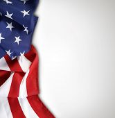 image of democracy  - Closeup of American flag on plain background - JPG