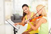 picture of preteens  - preteen girl play violin under music teacher - JPG