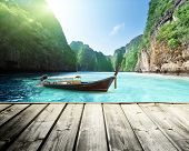 stock photo of phi phi  - rock of Phi Phi island in Thailand and wooden platform - JPG