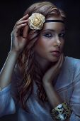 stock photo of hippies  - Glamour hippie girl posing on dark background toned low key portrait - JPG