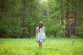 stock photo of beatitudes  - Young woman walking on a forest glade - JPG