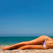 image of slender legs  - A girl with a beautiful slender figure against the sea - JPG