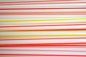 picture of non-biodegradable  - plastic drinking straws with red and yellow stripes - JPG