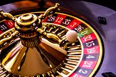 picture of loan-shark  - roulette game with game table and green poker chips - JPG