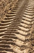 stock photo of plowing  - Traces of tractors on the plowed ground - JPG