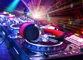 picture of laser beam  - Dj mixer with headphones at nightclub - JPG